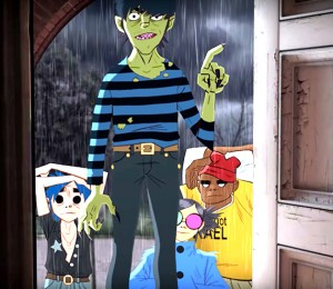 Gorillaz: Murdoc Niccals on the threshhold, with (l-r) 2D, Noodle, and Russel Hobbs backing him up.
